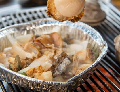 A grilled clam filled with the vibe of Busan's sea